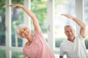 older adults doing yoga